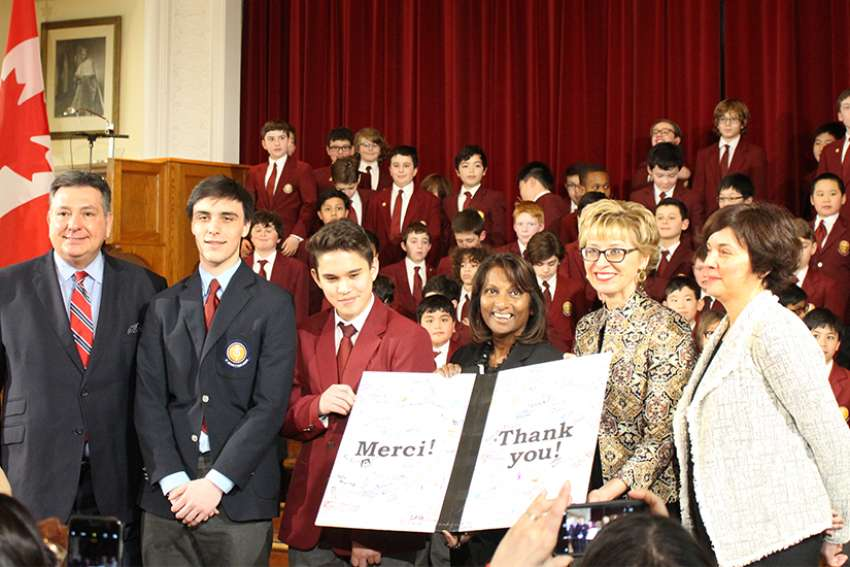Minister of Finance, Charles Sousa (left), Minister of Tourism, Daiene Vernile (second right), Minister of Education, Indira Naidoo-Harris (middle) receive a 'Thank you' card from St. Michael's Choir School students after the funding announcement was made Feb. 7, 2018.