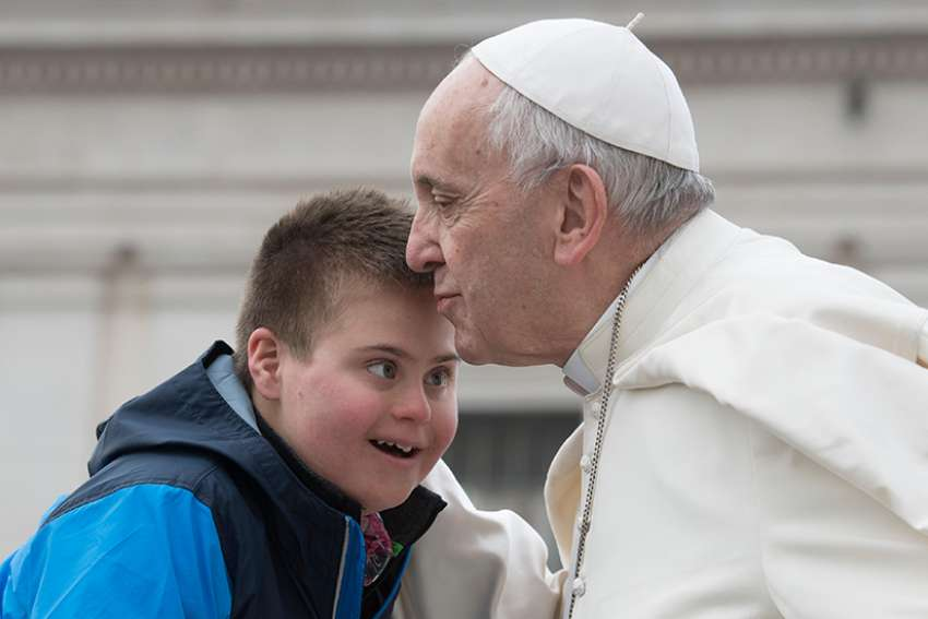 Pope Francis kisses Peter Lombardi, 12, of Columbus, Ohio, after the boy rode in the popemobile during his general audience in St. Peter's Square at the Vatican March 28. Receiving a kiss from the Pope was a wish come true for Peter, who has Down syndrome and has survived leukemia.