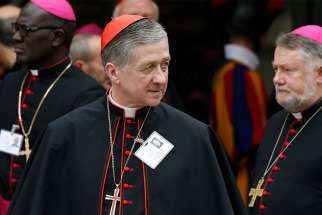 Cardinal Blase J. Cupich of Chicago leaves a session of the Synod of Bishops on young people, the faith and vocational discernment at the Vatican Oct. 11.