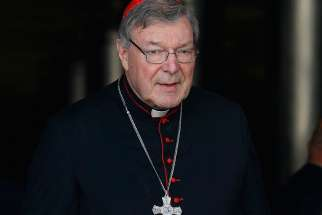 Australian Cardinal George Pell is seen in this Oct. 6, 2014 file photo at the Vatican. The Australian cardinal called for an inquiry into the leaking of accusations that he is under police investigation for the alleged abuse of minors.