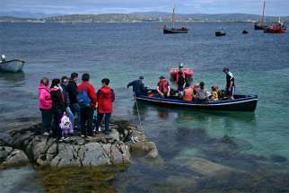 Seafarers and other worshippers from Carna, Ireland, are seen in 2016 during the annual pilgrimage to MacDara's Island to celebrate Mass in honor of St. MacDara, patron saint of fishermen. Pope Francis has granted Apostleship of the Sea chaplains broader permission for granting absolution to those working far from home.