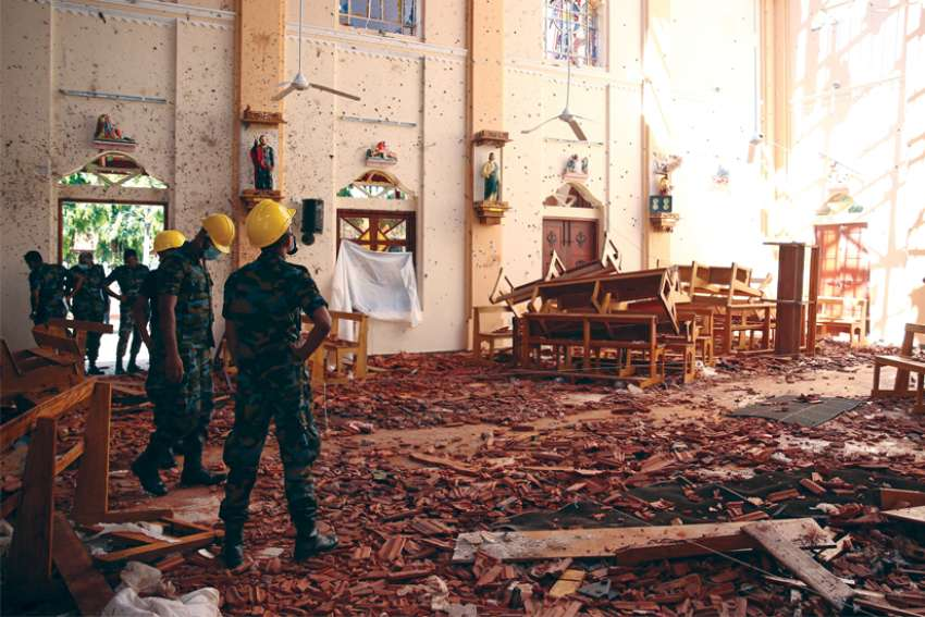 Officials look over the damaged St. Sebastian Catholic Church in Negombo, Sri Lanka, in the aftermath of the April 21 bombings across the nation.