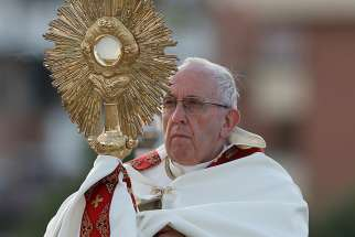 Pope Francis leads Benediction in observance of the feast of Corpus Christi in Ostia, a suburb of Rome, June 3.