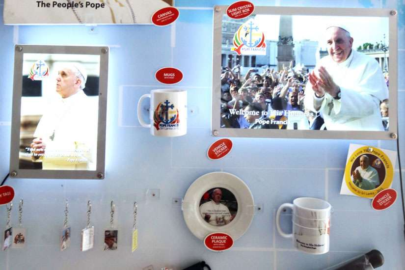 Souvenirs are displayed in early November in preparation for Pope Francis' Jan. 13-15 papal visit to Sri Lanka, at the Catholic Bookshop in Colombo, Sri Lanka. Church officials confirmed the visit will proceed as scheduled, despite its proximity to presidential elections.