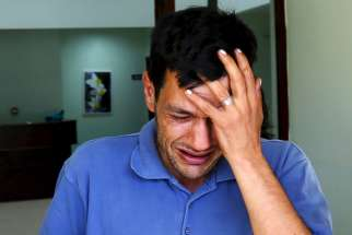 Abdullah Kurdi, father of three-year old Alan Kurdi, cries as he leaves a morgue in Mugla, Turkey, Sept. 3.