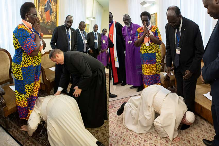 Pope Francis kisses the feet of South Sudan Vice President Rebecca Nyandeng De Mabior, left, and South Sudan President Salva Kiir, right, April 11, 2019, at the conclusion of a two-day retreat at the Vatican for African nation's political leaders. The pope begged the leaders to give peace a chance.