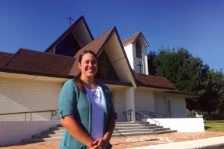 Sara Rodriguez outside her home parish of St. Malachy Church in Tehachapi, Calif.