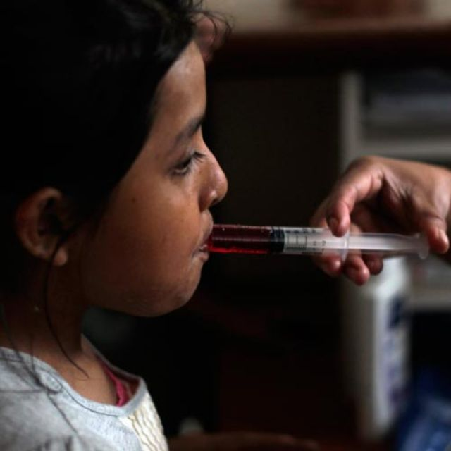 "A nurse uses a syringe to give liquid medicine to a young HIV patient at San Jose Hospice in Sacatepequez, Guatemala, in 2011. Pope Benedict XVI, speaking before World AIDS Day Dec. 1, said his thoughts and prayers were with ""the great number of children who contract the virus every year from their own mothers, despite the fact there are therapies for preventing it."""
