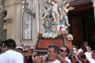 Townspeople of Mammola, Italy, carry the relics of San Nicodemo in a procession to the town's former Basilian abbey.