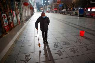 A man in Jiujiang, China, wears a face mask Feb. 3, 2020, as the country is hit by the coronavirus. The Vatican press office confirmed a report that appeared in the Chinese newspaper The Global Times, which said that since Jan. 27, the Vatican has sent 600,000-700,000 protective masks to China.