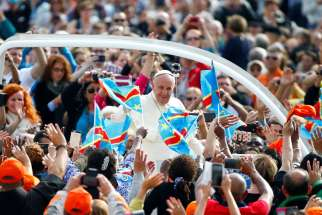 Pope Francis greets pilgrims as he arrives for his weekly audience Sept. 21 in St. Peter's Square at the Vatican. The Pope will be visiting the countries of Georgia and Azerbaijan between Sept. 30–Oct. 2, focusing on the themes of peace and reconciliation.