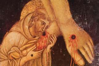 St. Francis kissing the feet of Christ, from a painting of a crucifix in Arezzo, Italy.