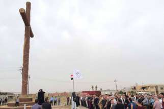 Syrian Catholic Archbishop Youhanna Boutros Moshe of Mosul blesses a newly-erected cross in Bakhdida, Iraq, May 2.