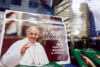 Pope Francis calendars are displayed for sale in a bookstore in Nairobi, Kenya. Fr. Stan Chu Ilo says the Pope specifically chose to visit Kenya, Uganda and Central African Republic for their strong faith traditions and their exponential growth in membership.