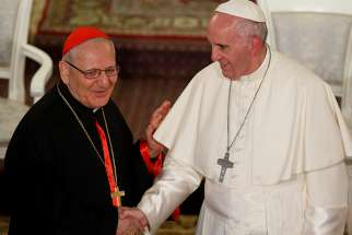 Pope Francis greets Chaldean Catholic Patriarch Louis Sako of Baghdad, Iraq, during a meeting with Chaldean Catholics at the Church of St. Simon the Tanner in Tbilisi, Georgia, in this Sept. 30, 2016, file photo.