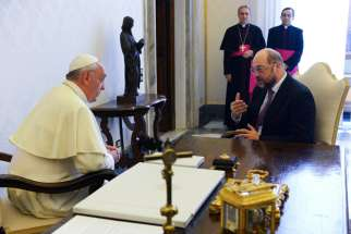 Pope Francis talks with Martin Schulz of Germany, president of the European Parliament, during a meeting at the Vatican in this photo dated Oct. 11, 2013.  Pope Francis will address the European Parliament in Strasbourg, France, Nov. 25.