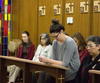 "Staff members pray the rosary in the Chapel of St. Thomas More in the Chancery of the Archdiocese of Galveston-Houston Jan. 31, joining parishes across the archdiocese for a rosary for ""healing in the church."" The prayer was said the same day Texas bishops released the names of clergy credibly accused of sexual abuse of minors."
