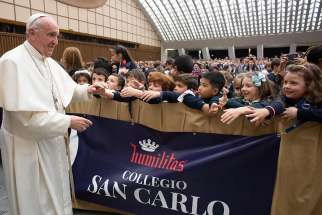 Pope Francis greets students from Milan's Istituto San Carlo during an audience at the Vatican April 6, 2019.