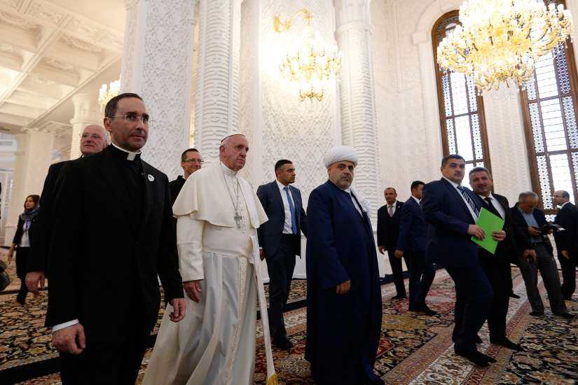Pope Francis walks with Sheik Allahshukur Pashazade, the region's chief imam, during a meeting with representatives of other religious communities at the Heydar Aliyev mosque in Baku, Azerbaijan, Oct. 2.