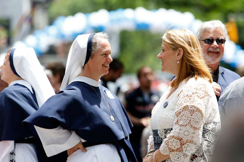 Sister Mary Elizabeth, vicar general of the Sisters of Life, speaks with a guest during a block party in New York City June 1 celebrating the religious community's 25th anniversary. The event was preceded by an anniversary Mass at St. Patrick's Cathedral.
