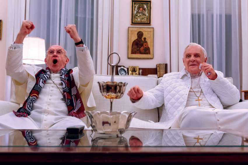 Jonathan Pryce as Pope Francis  and Anthony Hopkins as Pope Benedict in a scene from The Two Popes.