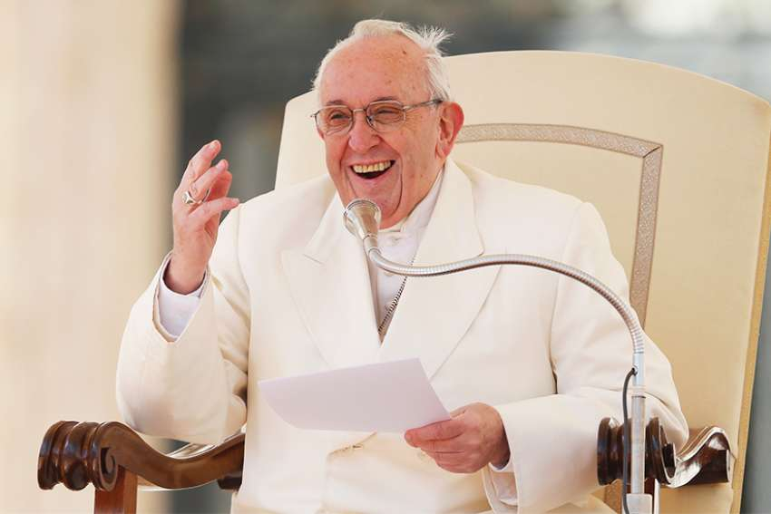 Pope Francis laughs after losing his zucchetto to a gust of window during his general audience in St. Peter's Square at the Vatican March 21.