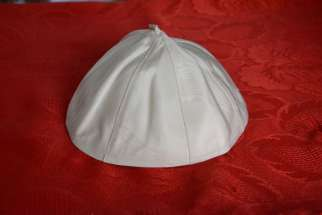 A skullcap worn by Pope Francis has been sold at auction for over $18,000.
