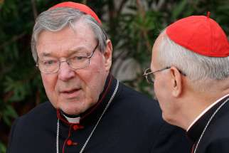 "Australian Cardinal George Pell, prefect of the Vatican Secretariat for the Economy, talks with Cardinal Peter Erdo of Esztergom-Budapest, Hungary Oct. 14, 2014. Pell noted the Pope's Laudato Si' encyclical had been ""well received"" but says the Church should be involved in scientific matters in an interview with Financial Times."