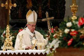 Pope Francis arrives the altar during a Mass marking the feast of the Epiphany in St. Peter's Basilica at the Vatican Jan. 6.