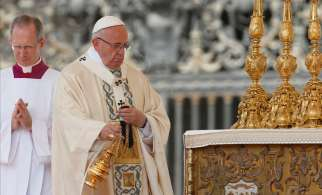 Pope Francis uses incense as he celebrates the canonization Mass for two new saints in St. Peter's Square at the Vatican June 5.