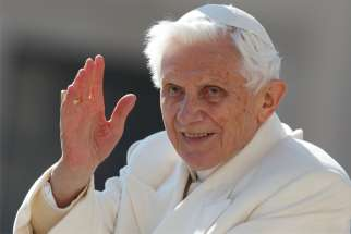 Pope Benedict XVI waves as he leaves his final general audience in St. Peter's Square at the Vatican in this Feb. 27, 2013, file photo.