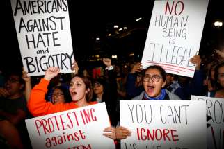 Demonstrators protest outside City Hall in Los Angeles Nov. 10 following President-elect Donald Trump's victory in the Nov. 8 election.