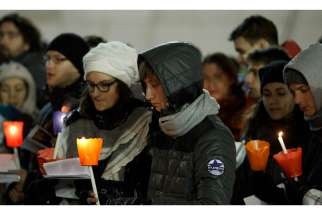 Young people hold candles as they participate in an ecumenical Taize prayer service St. Peter's Square at the Vatican Dec. 29, 2013.
