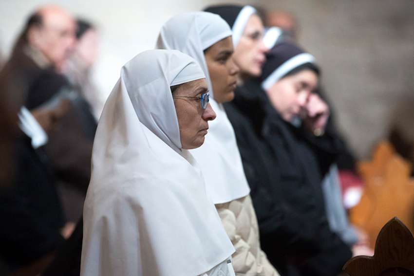 Nuns pray during Mass Jan. 6 in the Church of St. Catherine, adjacent to the Church of the Nativity, in Bethlehem, West Bank. The Mass was held by Catholics in the church as Orthodox Christians celebrated Christmas eve in the Church of the Nativity.
