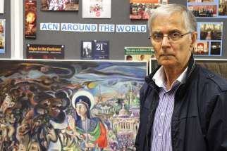 Farid Georges, a Syriac Christian from Homs, Syria, poses for a photo in England June 23. His artwork depicting Syria's six-year war is being shown in Catholic cathedrals of northwest England and Wales.
