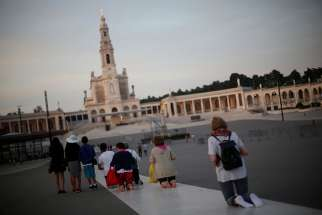 Pilgrims walk on their knees May 8 at the Marian shrine of Fatima in central Portugal. Pope Francis will declare the sainthood of Blessed Jacinta Marto and Blessed Francisco Marto, two of the shepherd children who saw Mary, during his visit to Fatima May 13.