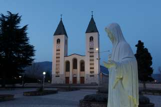 A statue of Mary is seen outside St. James Church in Medjugorje, Bosnia-Herzegovina, in this Feb. 27, 2011, file photo. Pope Francis has decided to allow parishes and dioceses to organize official pilgrimages to Medjugorje; no decision has been made on the authenticity of the apparitions.