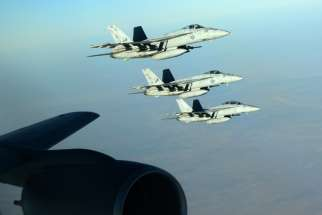 US Navy F-18E Super Hornets make a formation after receiving fuel from a KC-135 Stratotanker over northern Iraq Sept. 23. These aircraft were part of a large coalition strike package that was the first to strike Islamic State targets in Syria.
