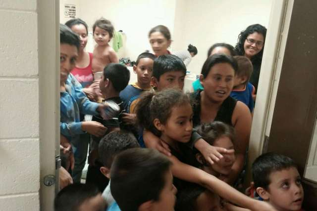 This handout photo courtesy of the office of U.S. Rep. Henry Cuellar, D-Texas, shows unaccompanied migrant children at a Department of Health and Human Services facility in south Texas. Many undocumented minors coming across the U.S. border claim they ar e escaping gang violence in their home countries.