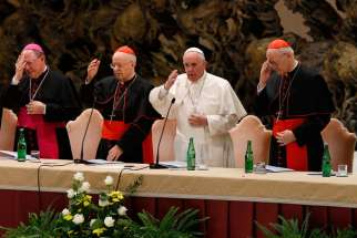 Pope Francis delivers his blessing during an event marking the 50th anniversary of the Synod of Bishops in Paul VI hall at the Vatican Oct. 17.