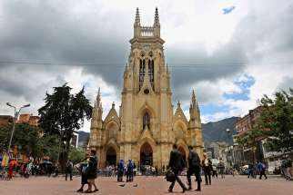 People walk in front of Our Lady of Lourdes Church in Bogota, Colombia, March 1. Vatican spokesman Greg Burke confirmed July 7 that Pope Francis will beatify Bishop Jesus Emilio Jaramillo Monsalve of Arauca and Father Pedro Ramirez Ramos during his September visit to the South American nation.
