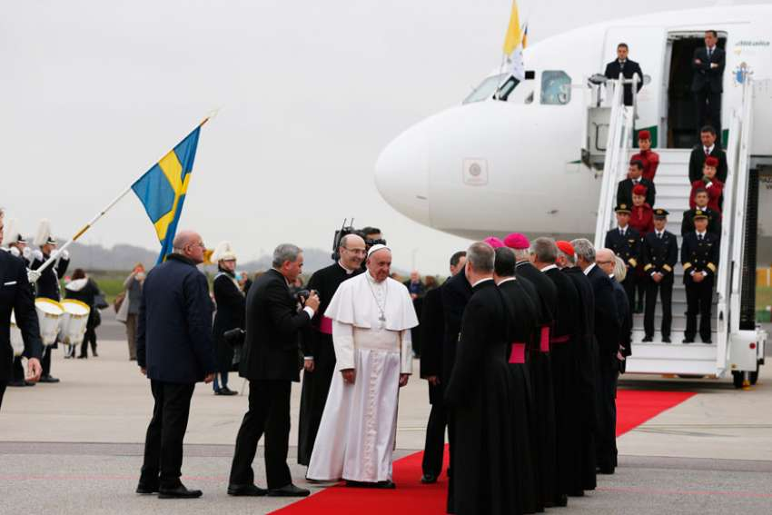 Pope Francis greets people as he arrives at the international airport in Malmo, Sweden, Oct. 31. The pope is making a two-day visit to Sweden to attend events marking the 500th anniversary of the Protestant Reformation.