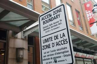Bubble zone street signs cite Bill 163 outside abortion clinics in Ottawa.