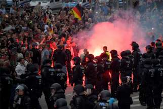 German riot policemen stand guard during a protest Aug. 27 in Chemnitz after a man was stabbed to death. German church leaders condemned anti-immigrant riots in Chemnitz, which erupted after a German man was killed in a brawl with migrants.
