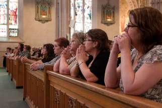 Women praying at St. Michael's Cathedral during a diaconate ordination ceremony in 2012. Bob Brehl it is time to rethink the role of women in Church.