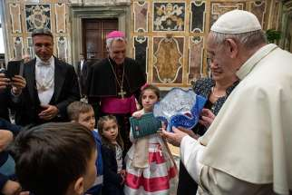 Pope Francis accepts a gift during an audience with members of the Italian Association of Organ Donors at the Vatican April 13, 2019. The pope said that when done ethically and free of charge, organ donation is a selfless gesture.