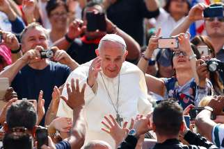 Pope Francis waves as he arrives to lead his general audience in St. Peter's Square May 10 at the Vatican.