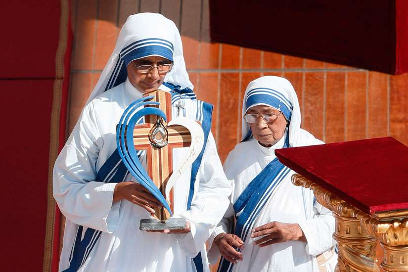 Missionaries of Charity nuns present a relic of St. Teresa of Kolkata as Pope Francis celebrates the canonization Mass of Mother Teresa in St. Peter's Square at the Vatican Sept. 4.