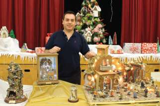 Francesco Ferrigno, who arrived in Canada from Italy four years ago, is surrounded by the Nativity scenes he created that are on display at St. Eugene Catholic School.