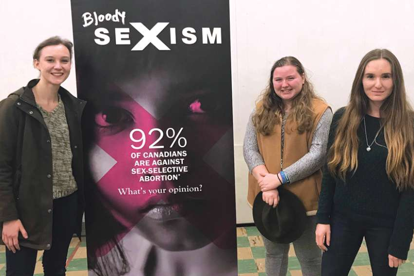 Mikayla Bezooyen, left, Nadja Kunz and Farrah MacPherson are looking to further the pro-life conversation at Mount Royal University.
